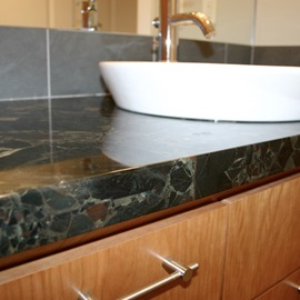 Laminated flat-eased granite